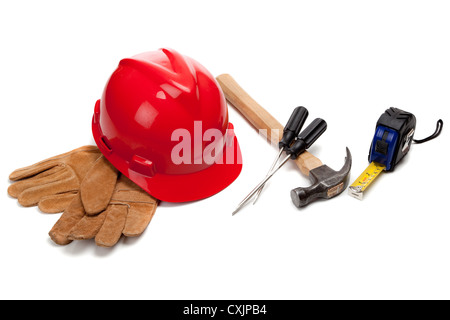 Red hard hat with various tools on a white background - Stock Photo