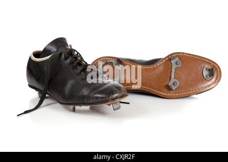 A pair of vintage baseball cleats on a white background - Stock Photo