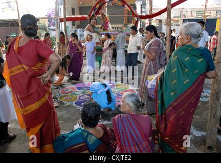 Making Kolam;Rangoli in front of kapaleeswarar temple during Arupathumoovar festival in Mayilapore, Chennai ,Tamil - Stock Photo
