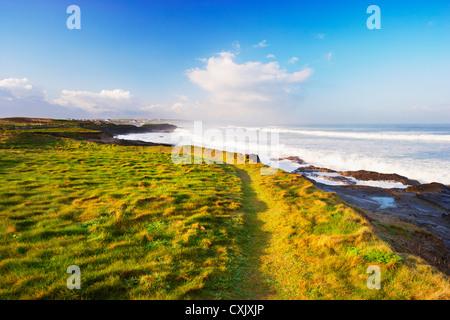 South West Coast Path leading around Grassy Coastline, Trevose Head, Cornwall, England - Stock Photo