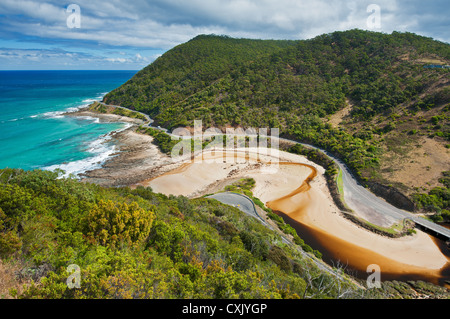 The Great Ocean Road winding its way along the coastline. - Stock Photo