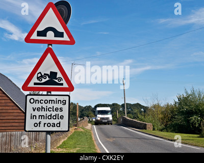 UK road sign warning of the danger of oncoming vehicles in the middle of the road. Oxfordshire England Europe - Stock Photo