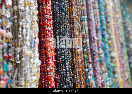 Long colorful glass necklaces Essaouira, Morocco - Stock Photo