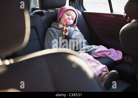 Portrait of Little Girl in Back Seat of Car - Stock Photo