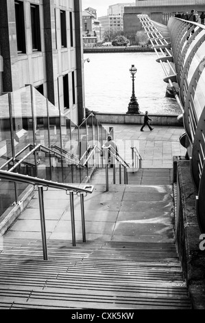 Steps alongside the Millennium Bridge lead down to the Thames in London, England. - Stock Photo