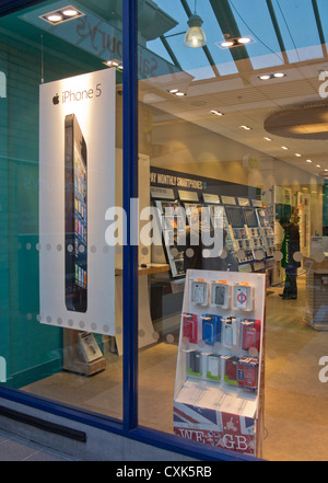 Newly launched iPhone 5 on sale at phone shop in London, UK - Stock Photo