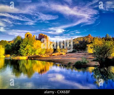 Cathedral Rock reflected in Oak Creek, Arizona - Stock Photo