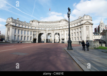 Elegant Edwardian exterior of Admiralty Arch as seen from The Mall in London, England on a sunny day - Stock Photo