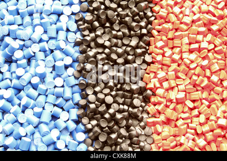 Colored plastic granules for extrusion work. - Stock Photo