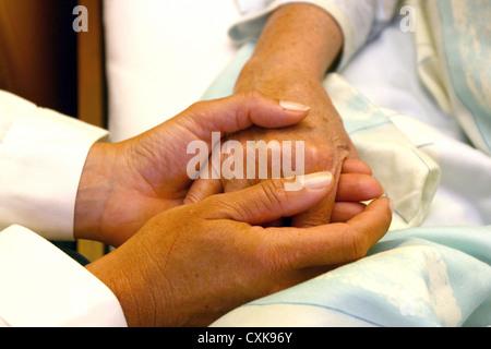 Senior citizen with a nurse - Stock Photo
