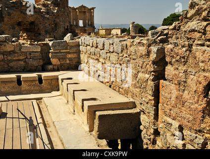 Roman toilets at UNESCO World Heritage Archaeological Site, Ephesus, Turkey - Stock Photo