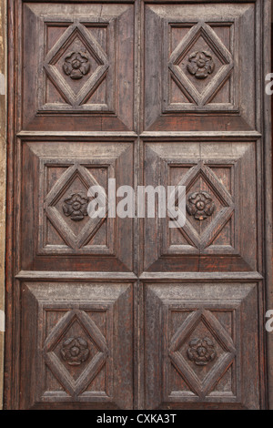 Wooden doorway at the St. Anastasia cathedral in Zadar, Croatia. - Stock Photo