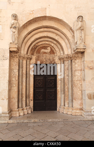 Arched doorway at the St. Anastasia cathedral in Zadar, Croatia. - Stock Photo