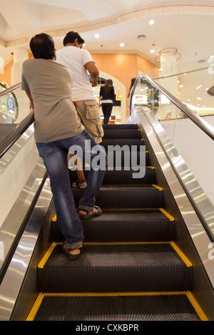 People on an Escalator in a Shopping Mall in Bangkok - Stock Photo