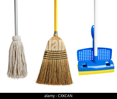 row of String mop, sponge mop and a straw broom - Stock Photo