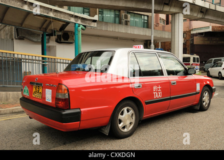 Red Hong Kong taxi HKSAR. - Stock Photo