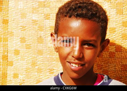 Eritrea, Asmara, close-up portrait of happy African boy on a sunny day - Stock Photo