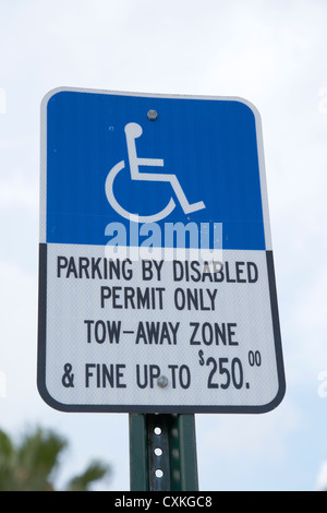 parking by disabled permit only tow-away zone fine sign miami florida usa - Stock Photo