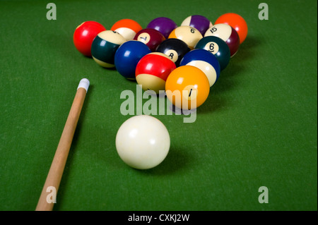 A set of billiards or pool balls on a green felt table with copy space - Stock Photo