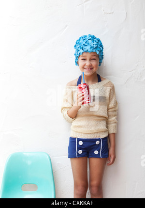Girl in bathing suit drinking soda - Stock Photo