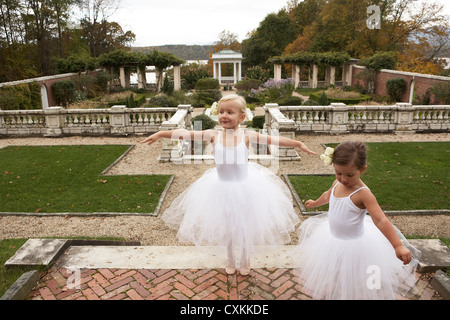 girls in tutu's dancing in a garden - Stock Photo