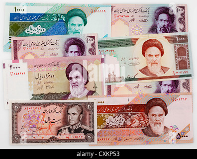 historic bank notes from Iran with portraits of Shah Mohammad Reza Pahlavi and Ruhollah Khomeini, - Stock Photo