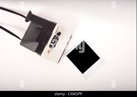 An instant transfer camera with a photographic print with clipping path for the image area - Stock Photo