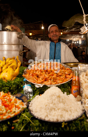 food vender at stall in Jamaa el Fna Square in Marrakech, Morocco - Stock Photo