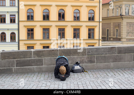 Beggar on the streets of Prague - Stock Photo