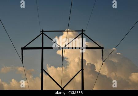 Power lines run through the Sonoran Desert in the lower foothills of the Santa Rita Mountains in Sahuarita, Arizona, - Stock Photo