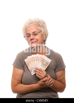 Happy mature woman holding money (euro bills) - Stock Photo