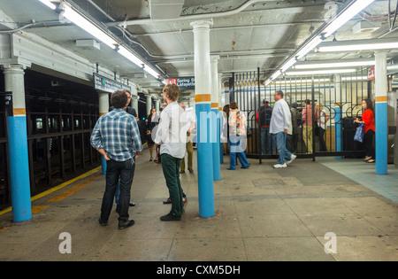 New York, NY, USA, People, Waiting for Train on Platform Bleecker Street Subway Train Station, Manhattan - Stock Photo