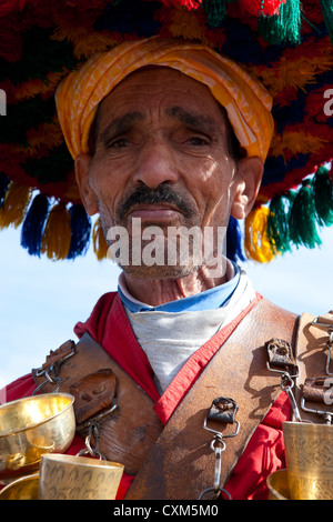 Saadian Tomb, Moroccan water seller in traditional dress in Djemaa el Fna square, Marrakech - Stock Photo