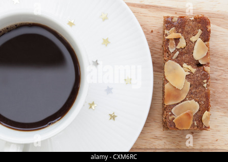 A coffee break with almond filled speculaas cake - Stock Photo