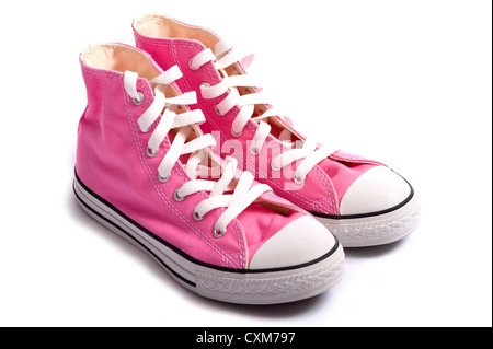 A pair of pink vintage styled canvas basketball shoes or sneakers on a white background with copy space - Stock Photo