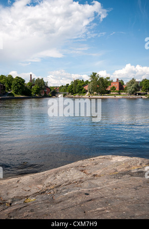 The Vantaa River in 'Old Town' part of Helsinki with the Museum of Technology on the distant shore - Stock Photo