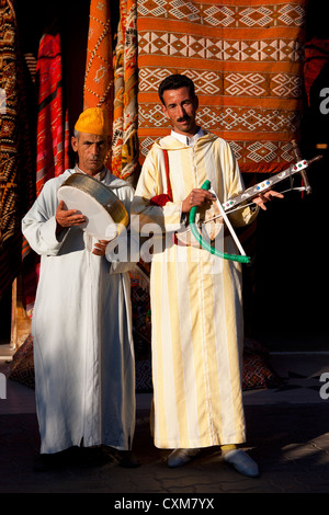 Moroccan musicians playing traditional musical instruments in the Djema el Fna square in Marrakesh, Morocco. - Stock Photo