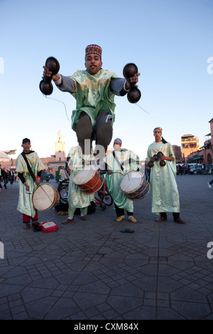 Dancers in traditional costumes in Jamaa el Fna Square in Marrakech, Morocco - Stock Photo