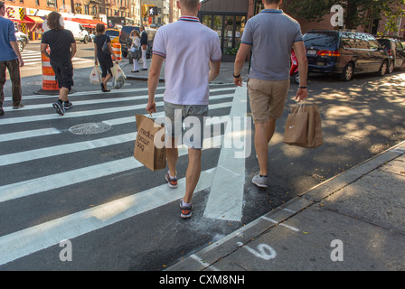 New York City, NY, USA, Street Scenes in the Greenwich Village, Men Carrying Shopping Bags, Crossing Street, urban - Stock Photo