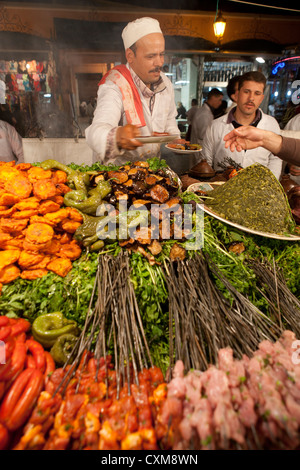 Jamaa el Fna Square in Marrakesh, Morocco Food Stalls Chicken Marinated Meat Vegetables Grill Skewers Kebabs Cheap - Stock Photo