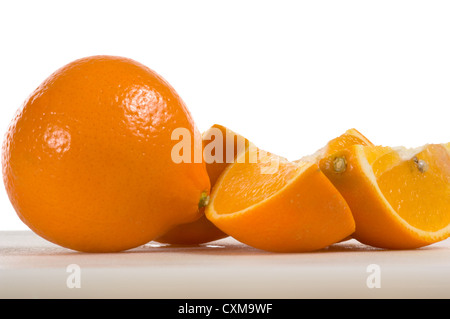 Freshly cut oranges on white background - Stock Photo