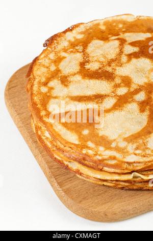 Stack of pancakes isolated on white background - Stock Photo
