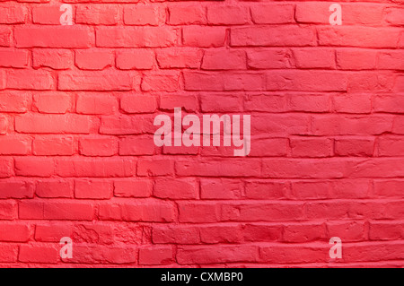 Stone texture - brick wall painted with red color. - Stock Photo