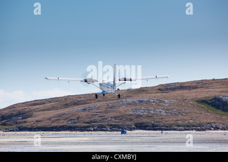 Aircraft taking off from the beach runway at Barra Airport, Isle of Barra, Outer Hebrides, Scotland, UK - Stock Photo