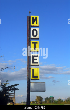 Old decaying motel sign along the famous Route 66 - Stock Photo