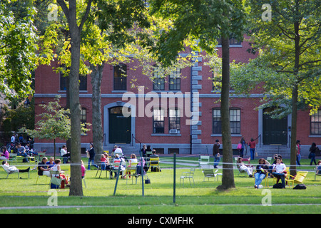 Students and tourists rest in lawn chairs in Harvard Yard, the old heart of Harvard University campus on September - Stock Photo