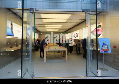 Customers inside the Apple store in Victoria Square, Belfast, Co Antrim, Northern Ireland, UK - Stock Photo