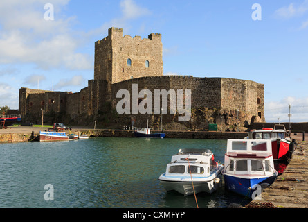 View across the water to 12th century Norman castle 1177 on Belfast Lough in Carrickfergus, County Antrim, Northern - Stock Photo