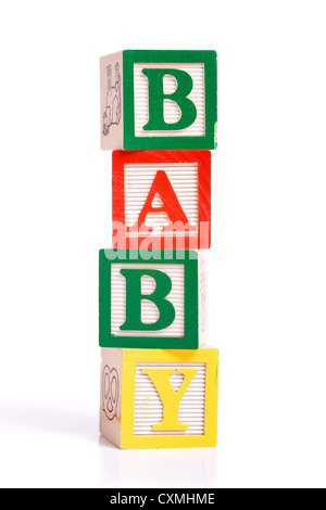 A stack of children's alphabet blocks spelling the word 'BABY' on a white background - Stock Photo