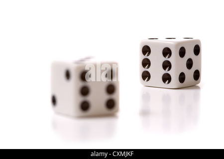 a set of White dice on a white background - Stock Photo